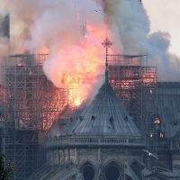 epa07508685 Flames on the roof of the Notre-Dame Cathedral in Paris, France, 15 April 2019. A fire started in the late afternoon in one of the most visited monuments of the French capital.  EPA/IAN LANGSDON